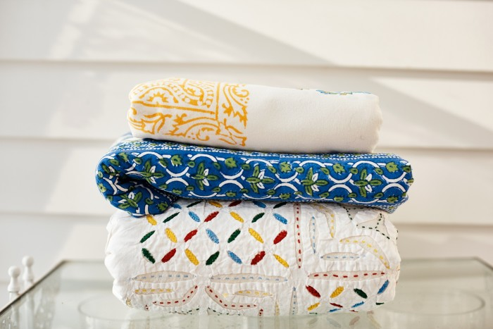 Colourful table linens brought back from India to mix and match on outdoor tables