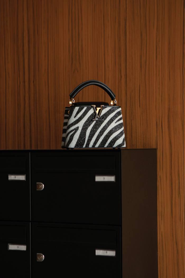Louis Vuitton leather and Swarovski-crystal mini Capucines bag, £5,250