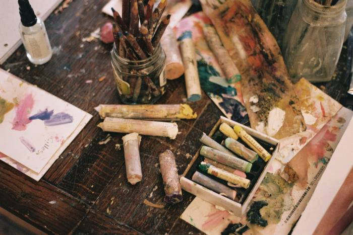 Oil pastels, pencils and materials used by Tangye