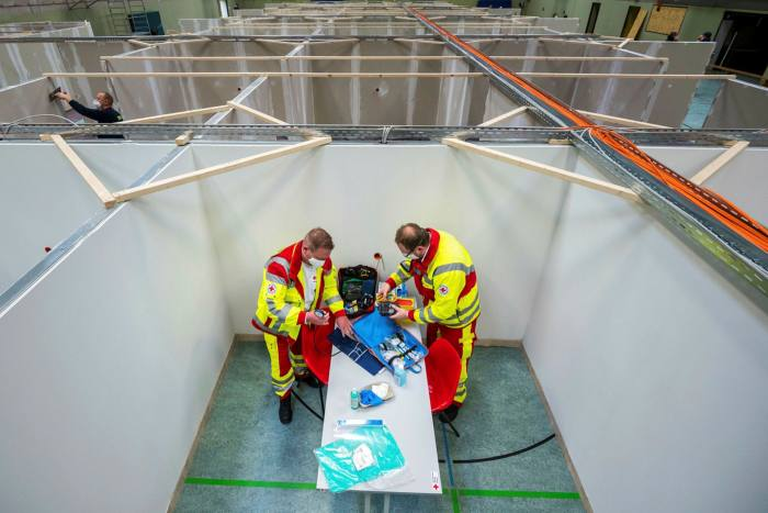 Members of the Red Cross and Germany's emergency response group THW assist in setting up a centre for vaccinations against Covid-19 in a converted gymnasium in Eschwege, Germany